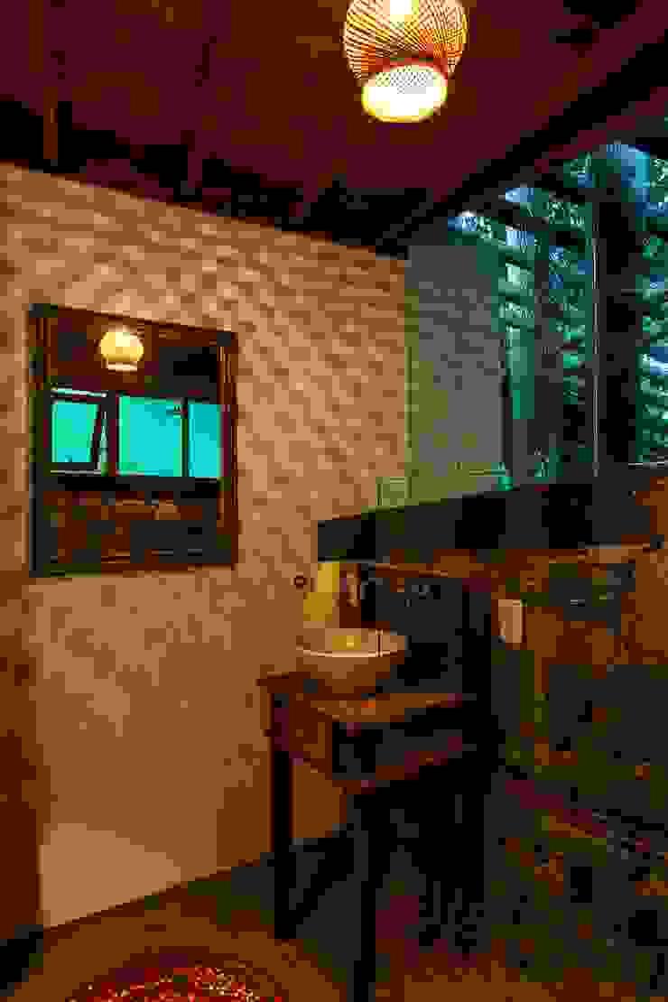 Casa da Floresta Banheiros campestres por Ferraro Habitat Campestre