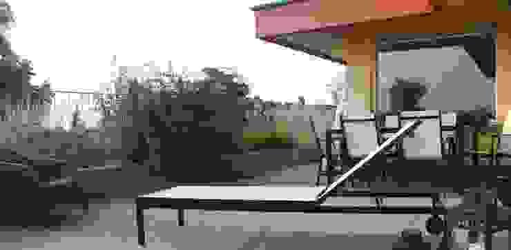 Terrazzo Case in stile minimalista di Officina s.r.l. Minimalista