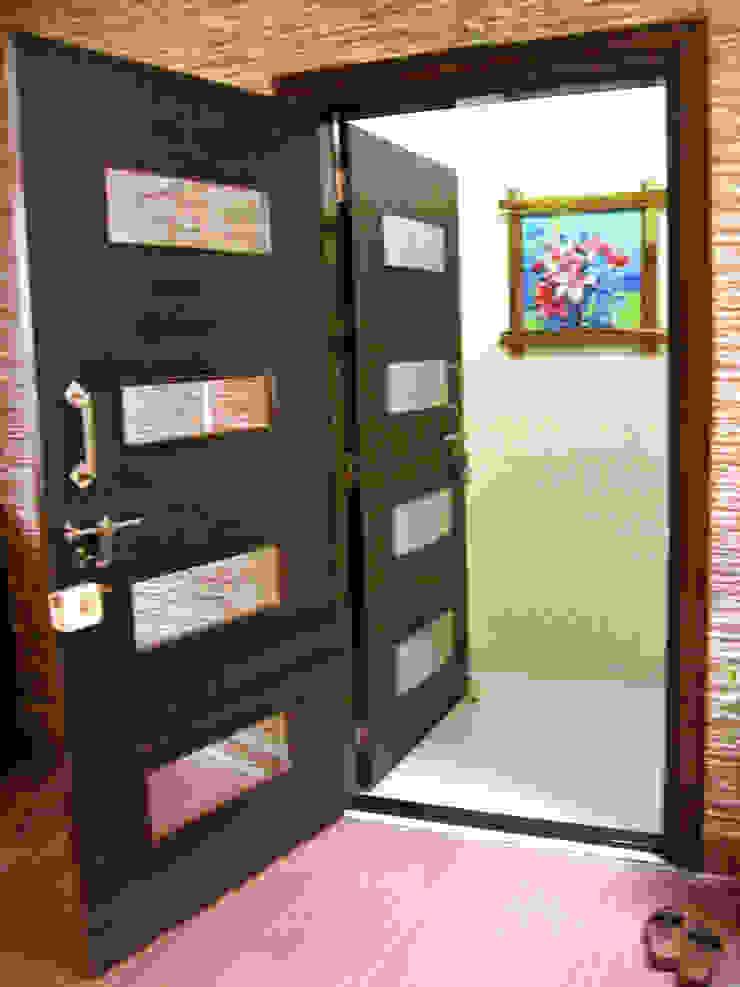 ENTERANCE DOOR WITH SAFETY DOOR: modern  by 4D The Fourth Dimension Interior Studio,Modern