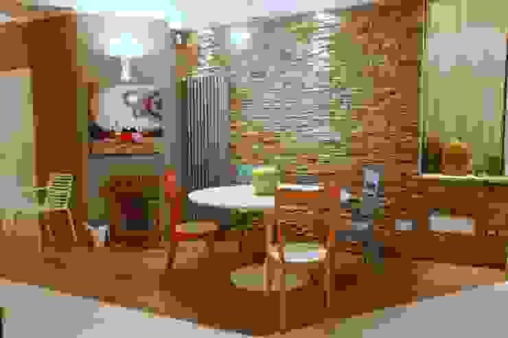 zona pranzo Case moderne di Architetto Monica Becchio Moderno