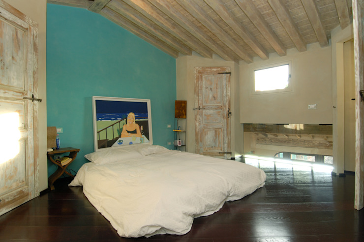 contrasti armonici Camera da letto eclettica di Angelo Sabella Architetto Eclettico