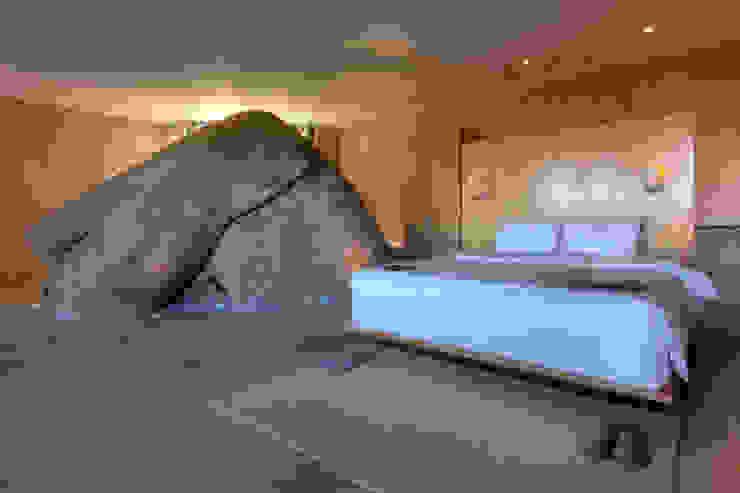 Hotel Encuentro Guadalupe Dormitorios rústicos de Gracia Studio Rústico