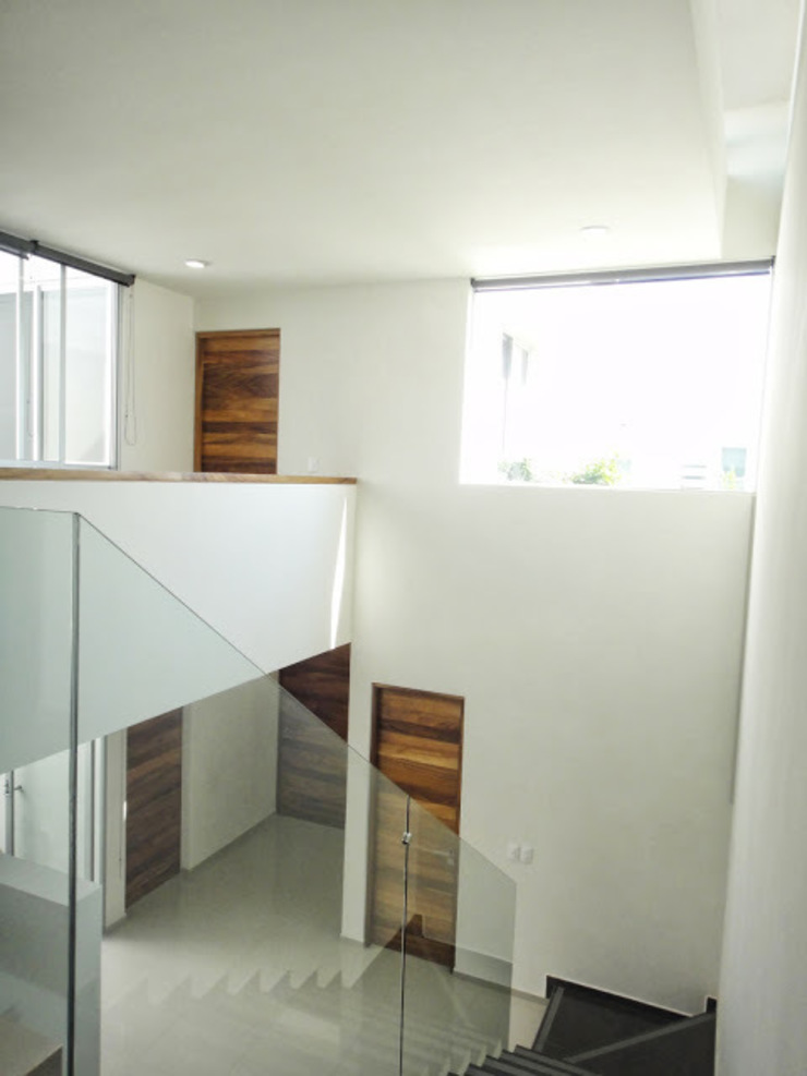 Modern Corridor, Hallway and Staircase by Abraham Cota Paredes Arquitecto Modern