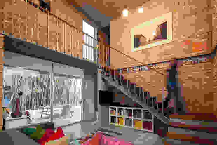 de estilo industrial por Garza Camisay arquitectos, Industrial