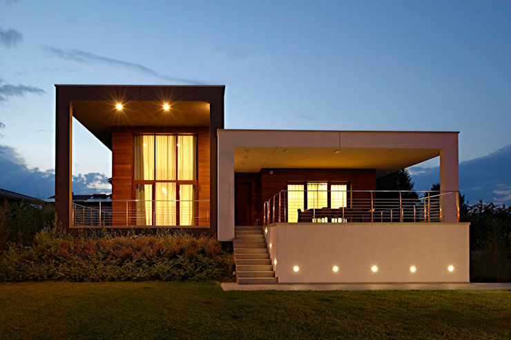 Facciata Anteriore Giardino minimalista di M A+D Menzo Architettura+Design Minimalista