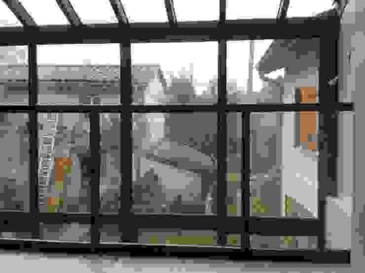 Maison ossature métallique Balcon, Veranda & Terrasse industriels par Carole Guyon architecte Industriel