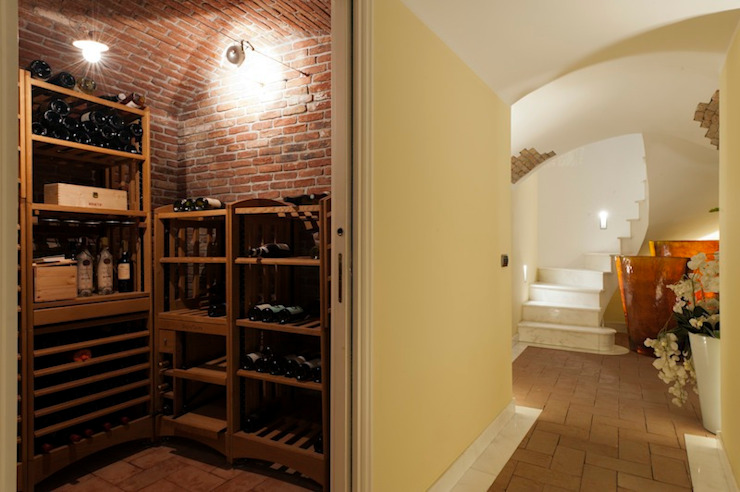 Wine cellar by studiodonizelli, Modern