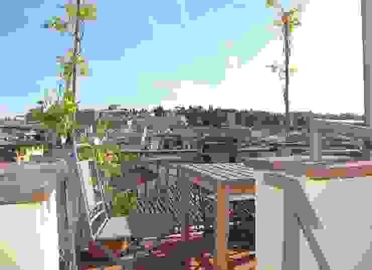 Ristrutturazione residenziale a Firenze Balcone, Veranda & Terrazza in stile moderno di de vita e fici architetti associati Moderno