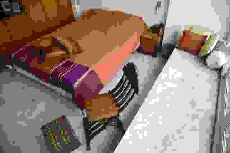 Intriguing Ikats TUNI Interiors Pvt. Ltd. BedroomTextiles