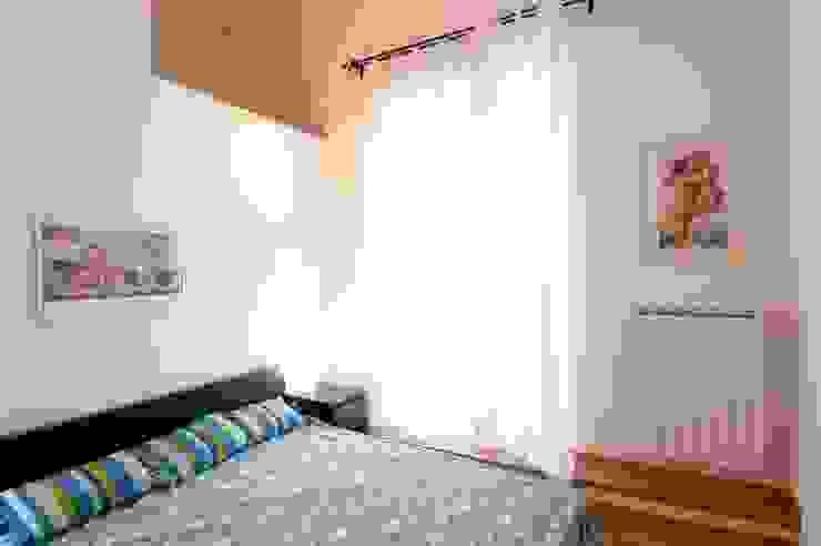 Restauro e frazionamento di un immobile residenziale ottocentesco a Firenze di de vita e fici architetti associati Eclettico