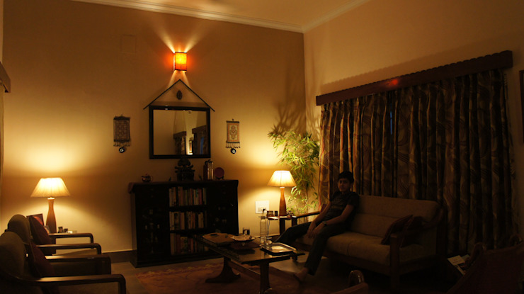 Renovation of an old Bunglow Rustic style living room by Anna Interiors Rustic
