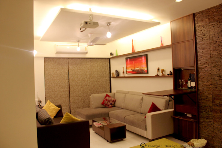 Living Room view: modern  by kaamya design studio,Modern