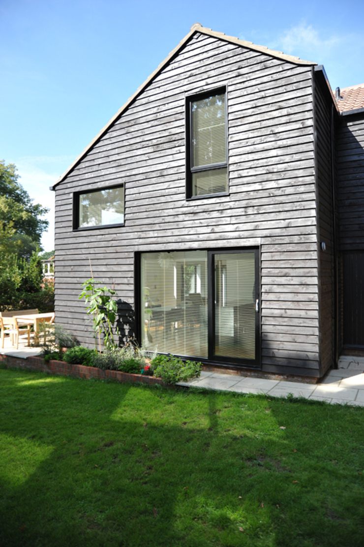 The East Facing Elevation of a 2-Storey Extension ArchitectureLIVE Modern home Wood Black