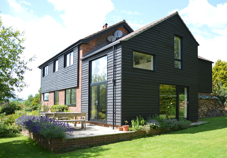 Extension & Refurbishment of 1960s House in West Sussex ArchitectureLIVE Modern home Wood Black