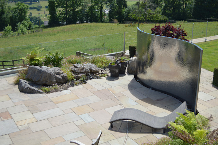 Stainless Steel Metal Water Feature Country style garden by Unique Landscapes Country