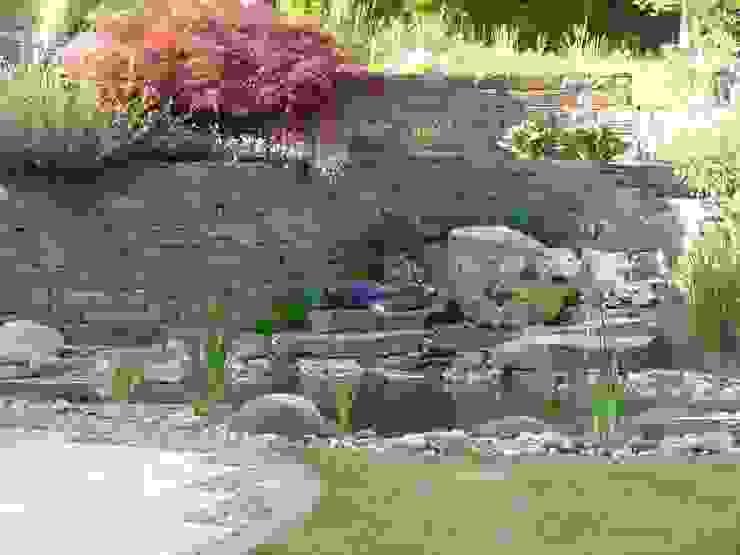 Gartenteich mit Quellstein von Gärten für Auge und Seele Mediterran