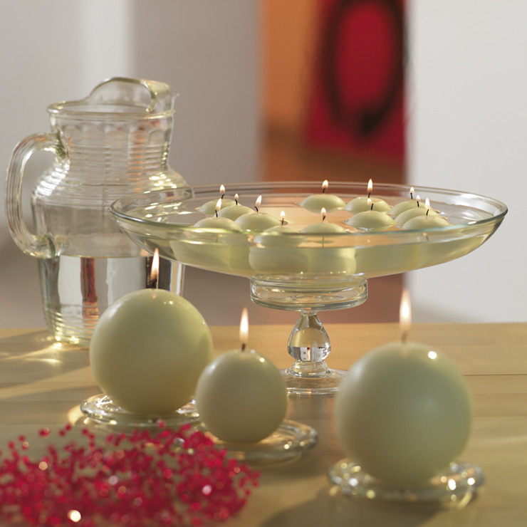 Ivory floating candles and ball candles: modern  by The London Candle Company, Modern