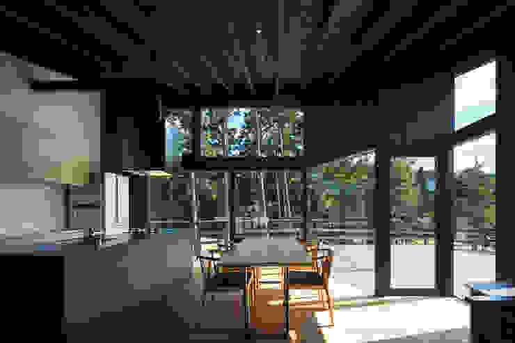 Modern dining room by 設計組織DNA Modern