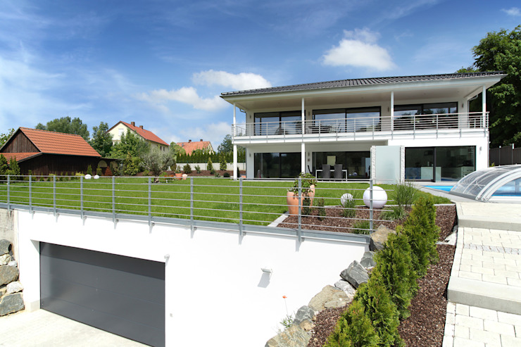 Jardines de estilo  por Bau-Fritz GmbH & Co. KG, Moderno