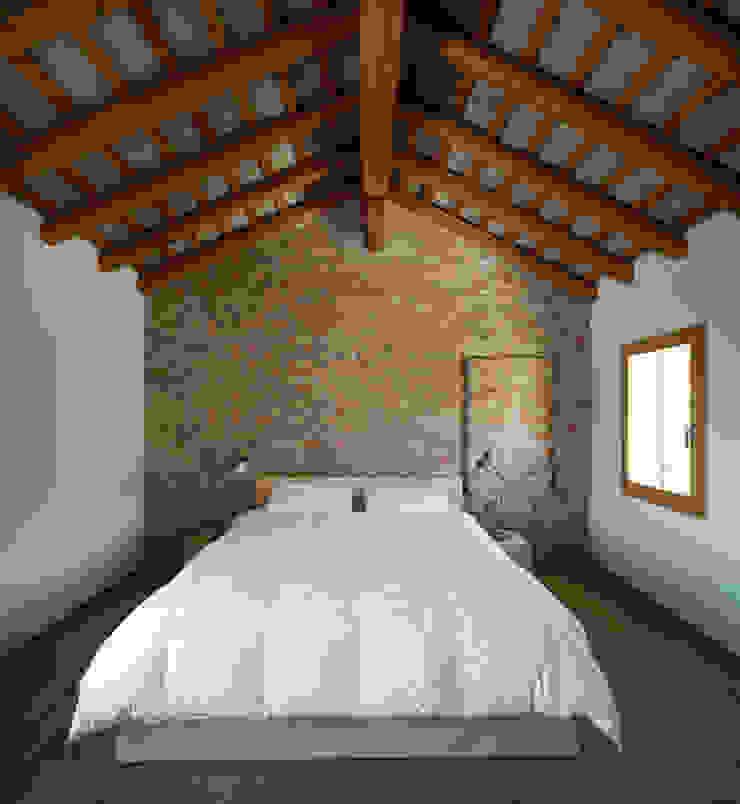 Casa Fiera Massimo Galeotti Architetto Camera da letto moderna Laterizio
