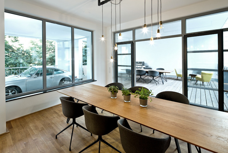 Cityloft Berlin Eclectic style dining room by DITTEL ARCHITEKTEN GMBH Eclectic