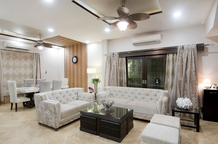 living room Living room by artha interiors private limited