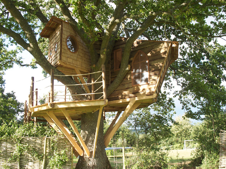 Imaginative Tree House Charm:  Garden by Squirrel Design Tree Houses Limited,