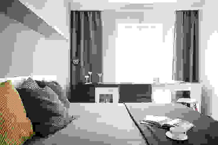 Dormitorios modernos: Ideas, imágenes y decoración de głodni STYLU pracownia projektowa Moderno
