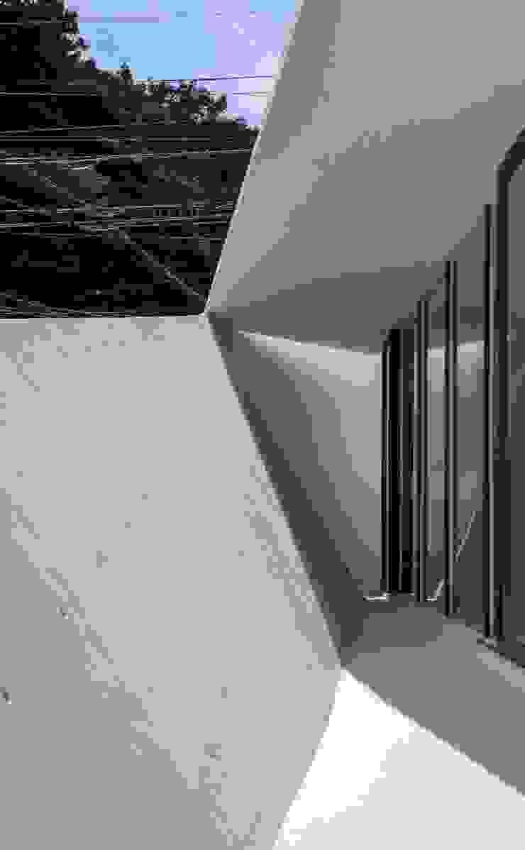 交差点 モダンな 壁&床 の 後藤武建築設計事務所 モダン