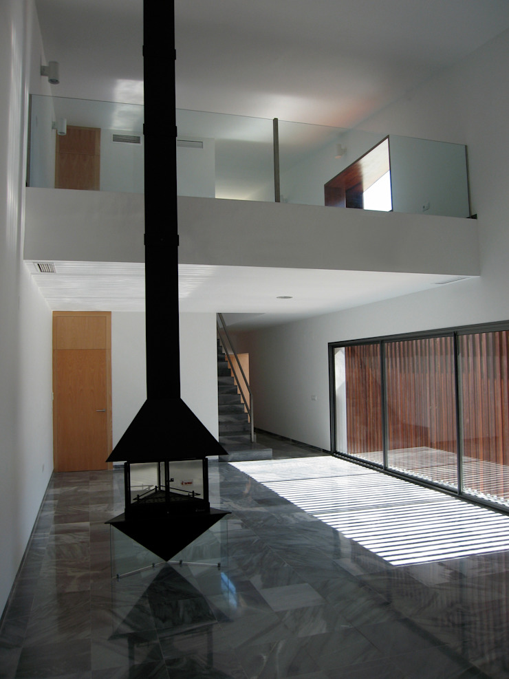 interiorismo Salones de estilo moderno de Arquitectura e Interiorismo en Cadiz Moderno