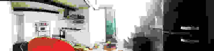 LA ZONA GIORNO Case in stile minimalista di Di Origine Progettuale DOParchitetti Minimalista