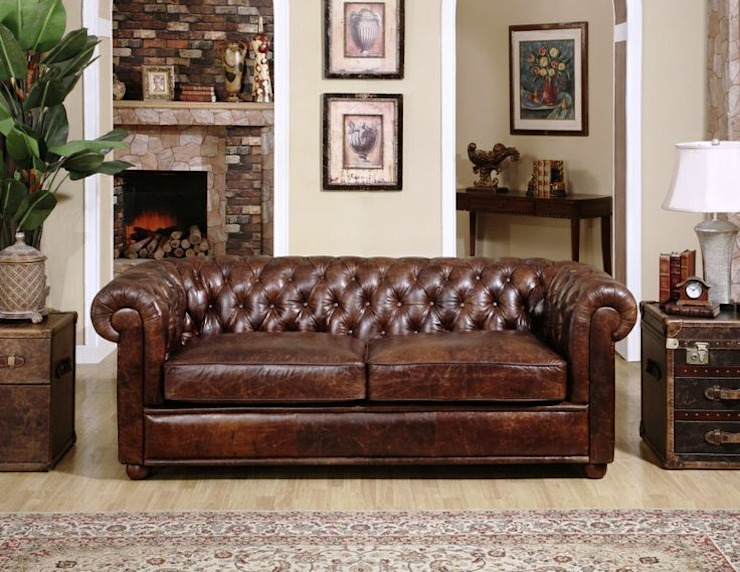 Leather Chesterfield Sofa :  Living room by Locus Habitat,