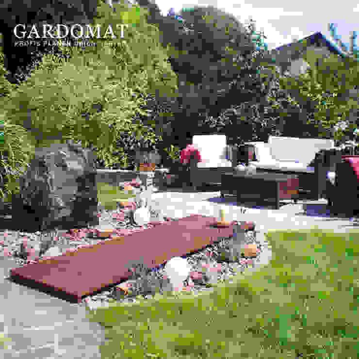 mediterraner Sitzplatz von GARDOMAT - Die Gartenideenmacher Mediterran