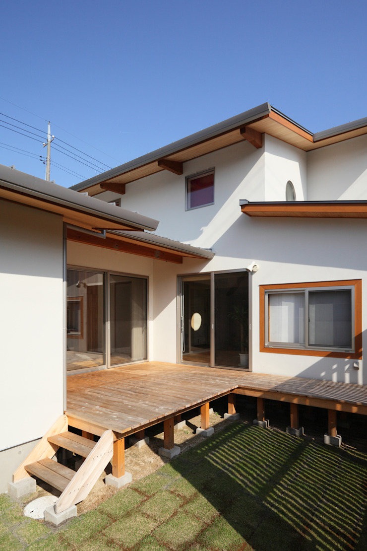 Eclectic style houses by ATELIER TAMA Eclectic