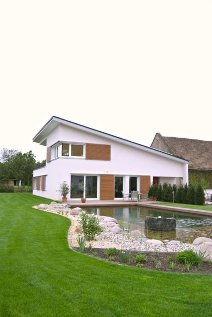 Einfamilienhaus in Osthofen Häuser von Julia Schlotter Design
