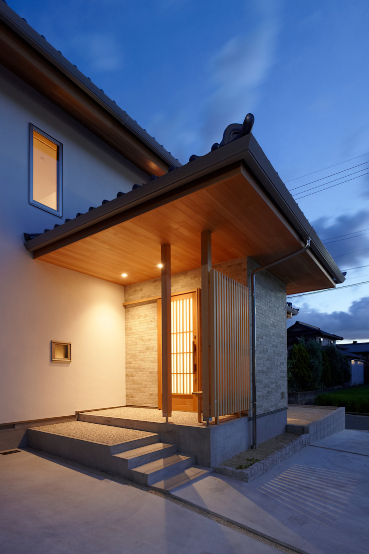 ATELIER TAMA Eclectic style houses