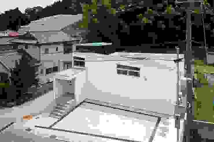 Spiral Roof Casas ecléticas por 諸江一紀建築設計事務所 Eclético