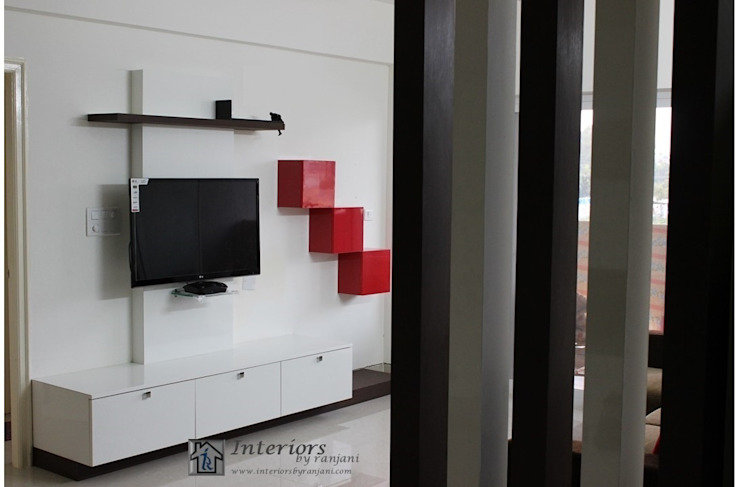 TV unit Modern houses by Interiors by ranjani Modern