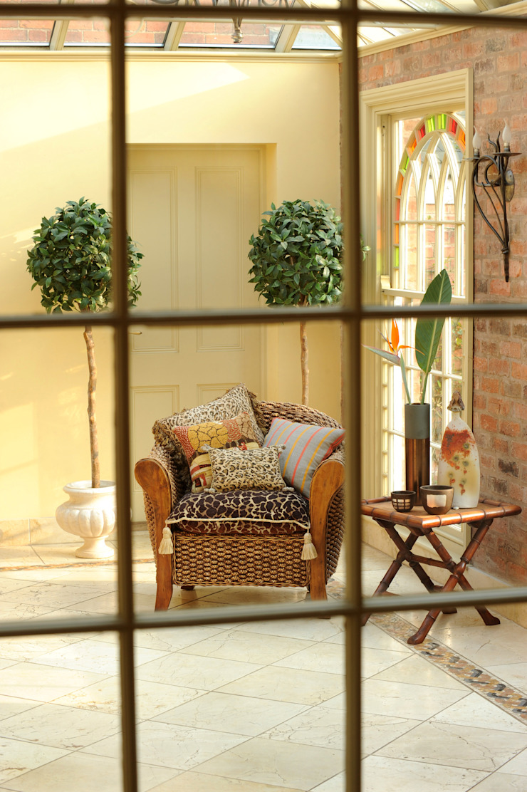 A fantastic garden room Eclectic style conservatory by Deborah Warne Interiors Ltd Eclectic