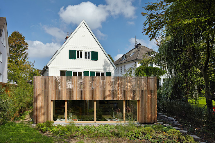 Eclectic style houses by Turck Architekten Eclectic