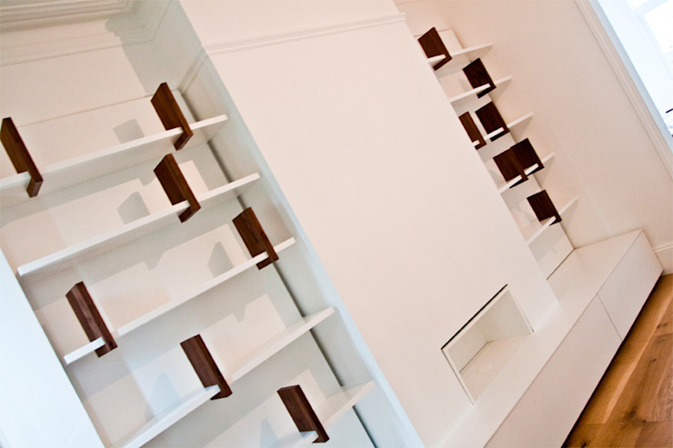 Bespoke Built-in Living Room Wall Dancing Bookshelf Modern living room by GO Modern