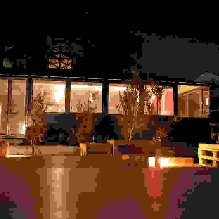 La veranda garden Allestimenti fieristici in stile industrial di Studio Arkilab - Seby Costanzo Industrial