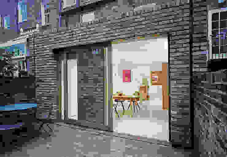 Sliding Oak Door by ABN7 Architects