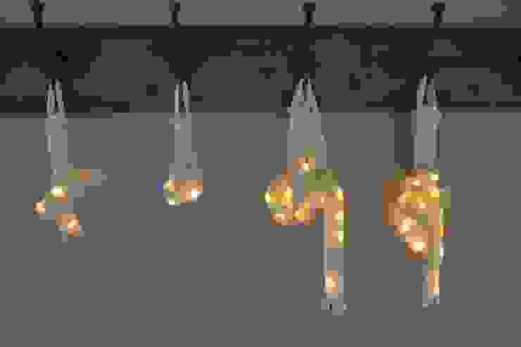 Tube de lumière - Lampe design - Laine naturelle feutrée par homify Éclectique