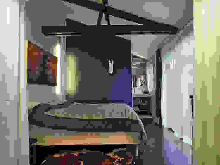 Camera da letto eclettica di BuroBonus Eclettico