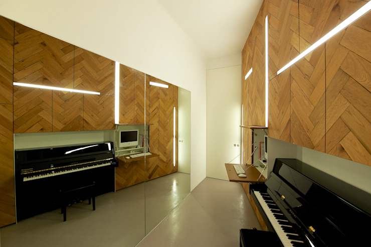 musikzimmer:  Multimedia-Raum von 3rdskin architecture gmbh,Ausgefallen