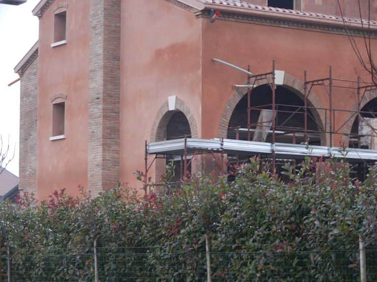 Intonaco esterno in cocciopesto Pareti & Pavimenti in stile rustico di B.Mid Rustico