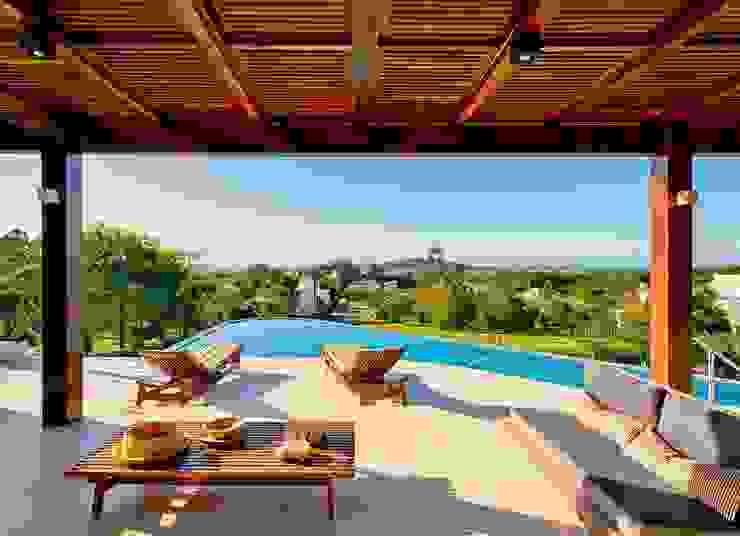 Varanda e piscina Varandas, alpendres e terraços modernos por Espaço do Traço arquitetura Moderno
