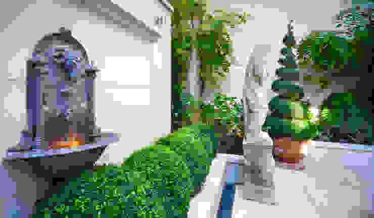 Outside walled garden. Rustic style balcony, veranda & terrace by David Hales Interior Design Rustic