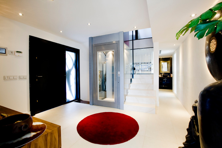 Recibidores Pasillos, vestíbulos y escaleras de estilo moderno de IPUNTO INTERIORISMO Moderno